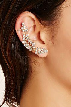 A high-polish set featuring one rhinestoned leaf ear cuff and a single rhineston. A high-polish se Fancy Jewellery, Prom Jewelry, Ear Jewelry, Stylish Jewelry, Cute Jewelry, Jewelry Accessories, Fashion Jewelry, Ear Crawler Earrings, Cuff Earrings