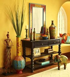 The entrance of her house has an accent wall with a mirror on the wall to make the space look bigger. This can well be the main decor piece and works very well with a nice antique wooden frame or even a sleek modern one, depending on the taste and decor. A sleek console table below can be placed with a vase.