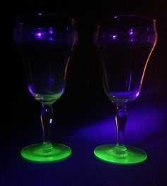 Clear etched pear shaped Depression glass goblets with green uranium glass base