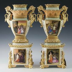 A pair of antique porcelain vases by Jacob Petit. The base features recumbent, gilded, dolphin motif columns at each corner, enveloping the center, hand painted Medieval era, Venetian scenes, further encompassed by gilded floral motifs. Atop the base, is a gothic style, gilt porcelain jagged edged railing enveloping the bottom of the turquoise hued stem embellished with gilded floral motif. The vases themselves are garnished with gilded, swan motif handles.