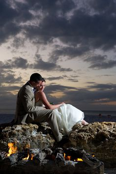 bonfire on the beach with the bride & groom, photo by Andi Diamond Photography