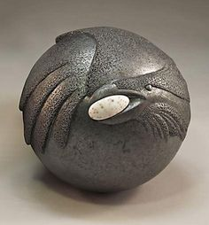 What amazing artistic vision to see the Raven in this rock (if that's how it was done?) - Ken and Pat Larson
