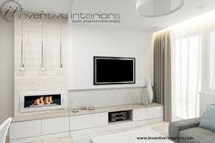 Projekt salonu Inventive Interiors - trawertyn na ścianie z białym biokominkiem