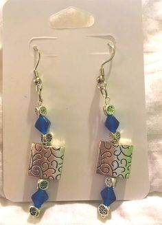 Earrings are 67 MM Long and 12 MM W. Sterling silver and nickel free with blue gem stones!   #nickelfree #jewerly #handmadeearrings #forsale #handmade #blue #squares