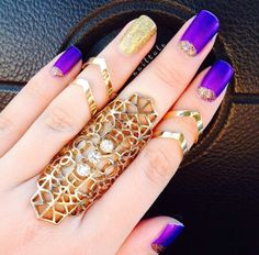 Gild rings and purple and glitter gold nails