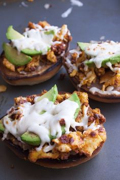 Molletes de Huevo con Chorizo y Aguacate    Toasted open-faced bolillos (Mexican rolls) topped with refried beans, eggs with chorizo, avocados, cheese, and salsa.