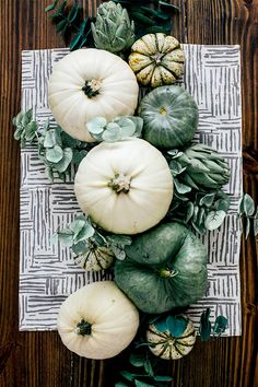 White pumpkin centerpiece perfect for an elegant and refined dinner party. This minimalistic and clean style would work fall through winter and doesn't look too holiday. Love.