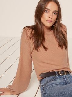 Like you never got out of bed. This is an easy fitting top with a mock neck and slightly billowy sleeves.