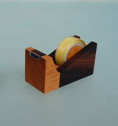 Taipo Tape Dispenser- Ethically made with sustainably sourced wood and finished with wood oil and wax. Handcrafted in the designer's workshop in Indonesia. Available at Design With Benefits. $19.50
