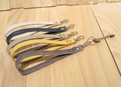 A clip on leather wrist strap, keychain, key holder handmade gift add to your pouch by bagonebagshop on Etsy