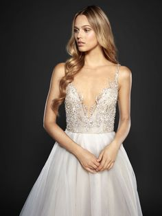 Style 6701 Kenny / Moondust organza A-line bridal gown, prismatic illusion bodice with bateau neckline and V-neck beaded detail, open net back with stardust frame, full organza skirt with slit. Also available in Ivory.
