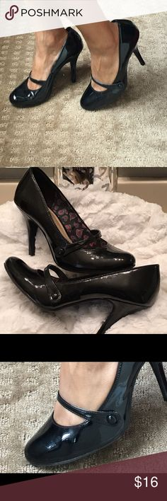 Adorable Mary Jane heels! Impeccable like new condition! Black patent leather Mary Janes with cute button detail. Heel height: 4 inches American Eagle by Payless Shoes Heels