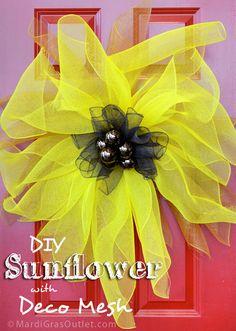 Deco Mesh Sunflower Wreath shown on a red door