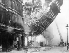 """Bomb damage to 23 Queen Victoria Street during the Blitz. """"The Salvation Army International Headquarters stood on Queen Victoria Street. It was photographed as its facade fell to the ground. London Museums, London City, London Wall, Le Blitz, Blitz London, The Blitz Ww2, Old Pictures, Old Photos, London Pictures"""