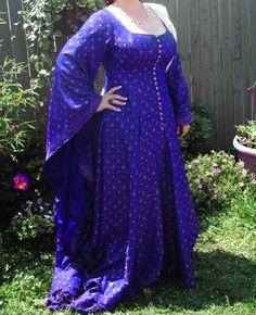 Pretty dress. Love the color!