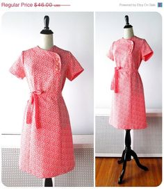 1960s Dress // Coral Pink and White 1960s Mod Mini dress with Asymmetrical Buttons.. $46.00, via Etsy.