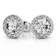The shimmer of diamonds and the clean elegance of a light-hued metal are brought together in this vintage-inspired accessory: The Pave Halo Diamond Earrings in White Gold! http://www.brilliance.com/earrings/halo-diamond-earring-settings-white-gold