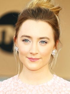 Saoirse Ronan opts for a pretty undone updo and a palette of soft silver and pale pinks