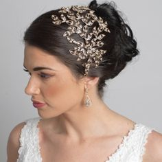 "Clear crystal rhinestones are hand set into this exquisite leaf & vine head band. It can be worn slightly raised or flat on the top of the head; and with or without a veil. You can secure this head band with straight pins or with the elastic band ( included ).  14"" L x 5"" W ( at its highest point )"