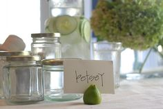 Glass jars from jams, salsas, etc can be reused along with fruits for a cheap design