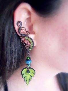 Hey, I found this really awesome Etsy listing at https://www.etsy.com/listing/185264175/peridot-ear-cuff-with-green-leaf-and