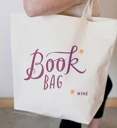 This heavyweight canvas tote is sturdy and roomy enough to carry all your books* (okay, wine). It measures 18 wide x 15 high x 6 deep, and is