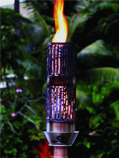 Outdoor Gas Tiki Torch - Hawaiin Hand Crafted Bamboo Tiki Torch Wanting to add that romantic fire in the air, or want to impress your guests, or create the perfect party. This specific model is created with Stainless Steel sleeve with Stainless Steel Base coated with a High Heat Powder Coat; uses a 24 Volt Electronic Ignition which is hidden in base. Visit www.RealPalmTrees.com for more info or call 888-RPT AGRO!!!