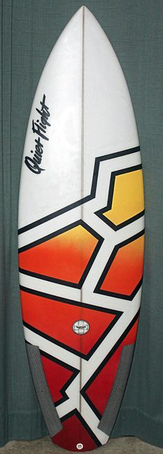 Dramatic geometric surfboard art. Can be accomplished with painters tape, acrylic spray paint, acrylic paint pens, acrylic gloss clear coat and painters mask. Artist Kaelin Darcy.