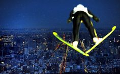 A competitor takes part in an official training session of the World Cup Ski Jumping competition January 30 as the lights of the city of Sapporo twinkle in the background