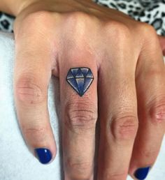 Blue Diamond Finger Tattoo