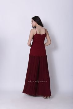 85245a1e7e4 This Maroon Jumpsuit comes with pleated pants and attached top