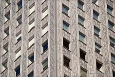 Steel, stainless, self cleaning geometrical pattern facade of Mobil Building http://www.ubminy.com/floor-cleaning-and-care