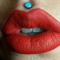 Philtrum piercing with light blue opal. Lime crime velvetine red on the lips.