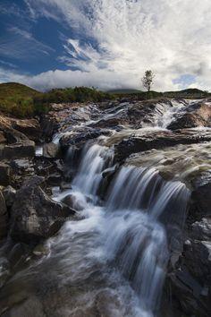 Sligachan River and tree silhouette. Sligachan. Isle of Skye. Scotland.