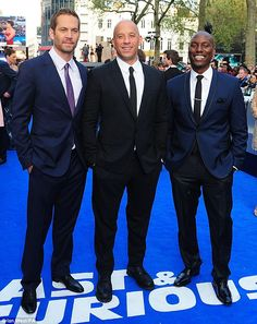 Suited and booted: The men made less of a flamboyant entrance as Paul Walker, Vin Diesel and Tyrese Gibson, who have been in all of the films, posed in their suits