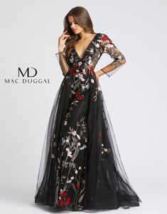Flowing column evening gown with dramatic overskirt and sweep train, illusion sleeves, semi raised floral embroidery, an array of matching glass stone work and v neck. Goth Wedding Dresses, Halloween Wedding Dresses, Princess Wedding Dresses, Boho Wedding Dress, Prom Dresses, Black White Wedding Dress, Fantasy Gowns, Long Sleeve Wedding, The Dress