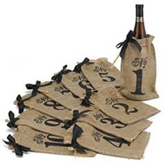 """Wine bottle burlap table numbers for your Rustic Reception! Affordable and super cute :) heather@theadplace.com for pricing!  Burlap Table Number Wine Bags  Burlap bags with table numbers in black and twine drawstring closure.  Product Details  Dimensions: 10 1/2"""" x 6 1/4""""  Price Includes: Wine bags numbered 1-10"""