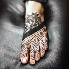 Guy With Hexagonal Tattoo With Dark Strip On Foot