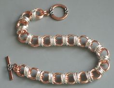 Copper and silver filled captive caterpillar chainmaille bracelet with copper and silver toggle clasp