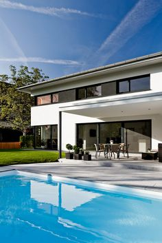 Detached house # Satteins # Solid construction # Pool # Modern single-family house # design House # with pool # Living design Source by steffi_smile_id Modern Family House, Dream Mansion, Mansions Homes, Garden Pool, House Goals, Detached House, Swimming Pools, Canopy, House Styles