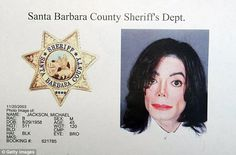 New details: The police report from the 2003 search of Michael Jackson's Neverland Ranch has been released (Jackson in his 2003 mugshot above)
