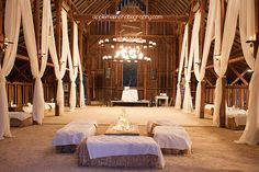 The dance floor, white drapery, and hay bale seating inside the barn. #rustic #glam #wedding | Hello Friday Events - San Luis Obispo, CA