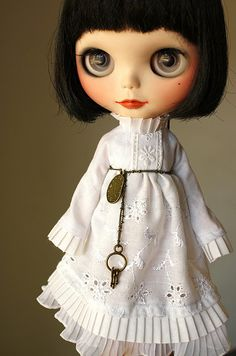 Grey eyes with black hair, wearing white-pretty.