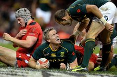 South Africa's Jean de Villiers (C) reacts after scoring a try during the International rugby union test match between Wales and South Africa at the Millennium Stadium in Cardiff, south Wales, on November 9, 2013. AFP PHOTO/ANDREW YATES