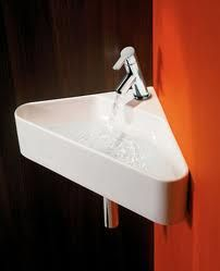 corner sink.....want this for our tiny bathroom.