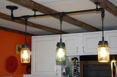 This is an interesting take on a mason jar light. I really like the black pipe...
