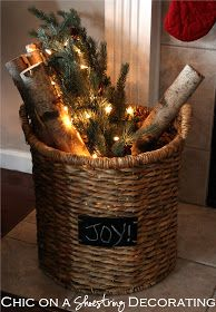 Love this! birch branches/greenery/lights/basket w/joy..