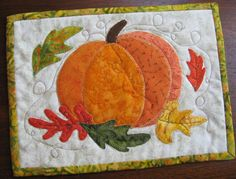 Autumn Pumpkin Mug Rug pattern $2.00 on Craftsy at http://www.craftsy.com/pattern/quilting/home-decor/autumn-pumpkin-mug-rug/61451