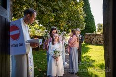Happy flower girl smiling as she and bridesmaids wait outside church with vicar before wedding ceremony in Dorset. Documentary photo by one thousand words. Church Wedding Ceremony, Vicars, One Thousand, Before Wedding, Happy Flowers, Flower Girls, Documentary, Bridesmaids, Church Weddings