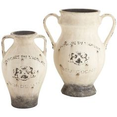 """Vineyard Distressed Vases. """"Can't make it to a French wine region this year? You can still enjoy vineyard charm with these rustic earthenware vases. Handcrafted, heavy and inscribed with regional insignias, these can be displayed alone or grouped with antique finds and distressed woods. Suddenly, you want a glass of wine, don't you?"""" #Unicorn #Pier1"""